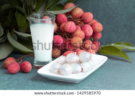Fresh juicy lychee fruit on a glass plate. Organic leechee sweet fruit with litchy juice. Organic lychee fruit concept. Exotic tropical litschi berry. Peeled lychee fruit. Advertising with lychee. #1429585970
