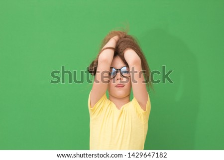 child enjoys hairstyles, little girl playing with hair  #1429647182