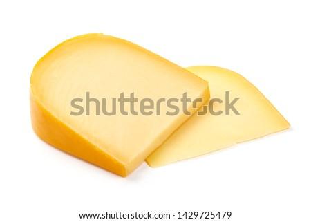 Hard Dutch gouda cheese, close-up, isolated on white background. #1429725479