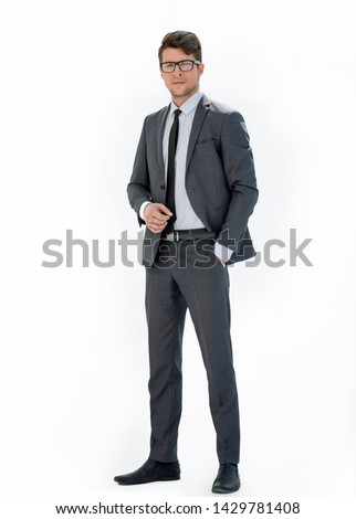 in full growth.portrait of a confident businessman. #1429781408