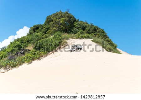 Beautiful aerial image of dunes in the Natal city, Rio Grande do Norte, Brazil. Royalty-Free Stock Photo #1429812857