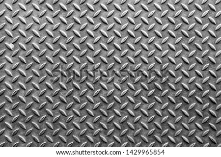 Rusty steel plate texture and background. Old grungy metal floor seamless of steel sheet metallic. It's silver with rhombus shapes for design art work, backdrop or skin product. #1429965854