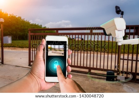 The hi technology 4.0 person used CCTV system order to open lock motor automation gate home security system by smartphone signal. #1430048720