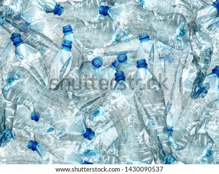Background of many used empty PET bottles Royalty-Free Stock Photo #1430090537
