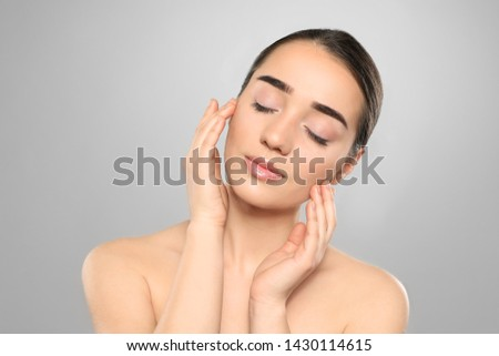 Portrait of young woman with beautiful face against color background #1430114615
