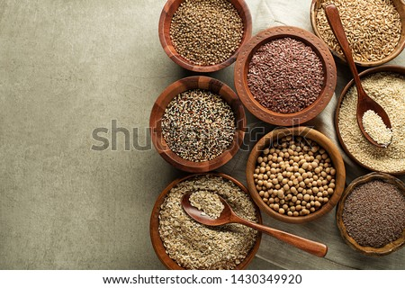 Various of healthy seeds and cereals - sesame, flax seed, chia seeds, soybean, buckwheat and oats. Copy space. #1430349920