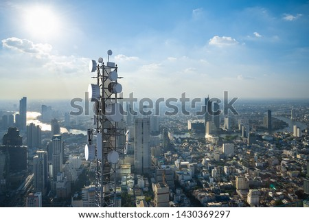 Telecommunication tower with 5G cellular network antenna on city background Royalty-Free Stock Photo #1430369297