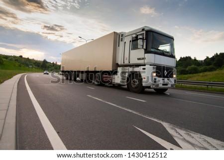 Vilnius/Lithuania June 12, 2019  White Renault Magnum semi-trailer truck on the road. #1430412512
