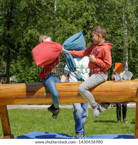Yekaterinburg, Russia, June 15, 2019. Fight bags sitting on a log. Traditional national holiday Sabantuy in the city park. #1430436980