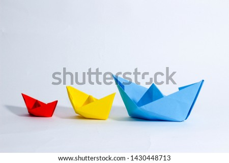Colorful paper color. Ship shape of origami.  Easy origami shape to build. Origami with white background. Different size of ship shape. #1430448713