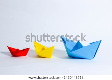 Colorful paper color. Ship shape of origami.  Easy origami shape to build. Origami with white background. Different size of ship shape. #1430448716