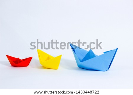 Colorful paper color. Ship shape of origami.  Easy origami shape to build. Origami with white background. Different size of ship shape. #1430448722