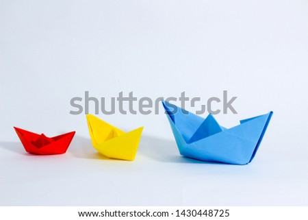 Colorful paper color. Ship shape of origami.  Easy origami shape to build. Origami with white background. Different size of ship shape. #1430448725
