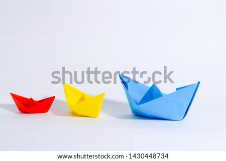 Colorful paper color. Ship shape of origami.  Easy origami shape to build. Origami with white background. Different size of ship shape. #1430448734