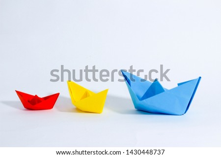 Colorful paper color. Ship shape of origami.  Easy origami shape to build. Origami with white background. Different size of ship shape. #1430448737