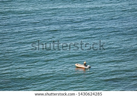 Man on a boat in the baltic sea. #1430624285
