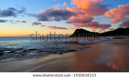 Hawaiian golden sunset followed to twilight.  Photos include sky as it changes from gold to light pink and orange.  Also photos show beach, sand, reef and waves washing up on shore and reef. #1430636513