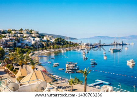 View of Bodrum Beach, Aegean sea, traditional white houses, flowers, marina, sailing boats, yachts in Bodrum town Turkey.  #1430703236
