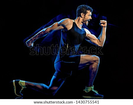 one caucasian player man exercising fitness cardio boxing exercise body combat studio shot isolated on black background with light painting blur effect Royalty-Free Stock Photo #1430755541