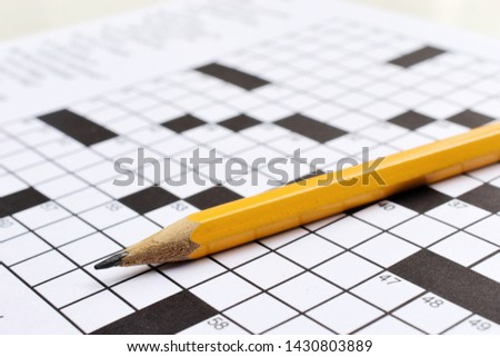 Crossword puzzle and a pencil on the table #1430803889