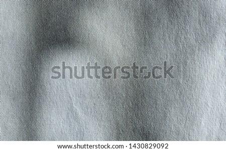Macro image of grey halftone gradient dots on newsprint #1430829092