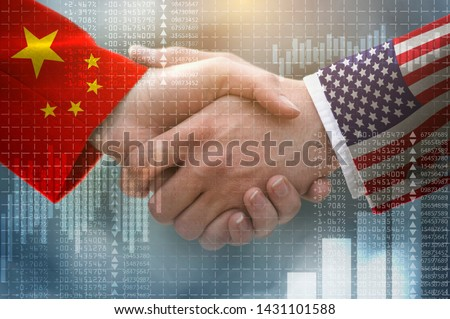 two businessman shake hands, China–United States trade war Royalty-Free Stock Photo #1431101588