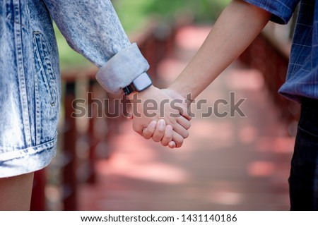 The couple holding hands shows love on the day of love. The Day of Love - Image