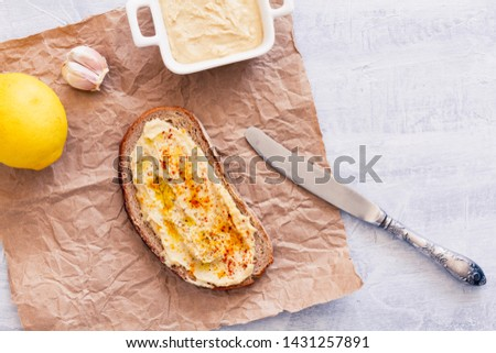 Hummus sandwich with country rustic bread. Top view, above view or overhead view composition #1431257891