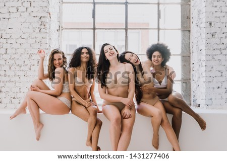 Group of women with different body and ethnicity posing together to show the woman power and strength. Curvy and skinny kind of female body concept #1431277406