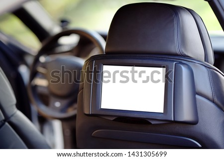 Car inside headrest screen mock up. Interior of prestige luxury modern car. One white display for back seats passenger with copy space and place for text. Royalty-Free Stock Photo #1431305699