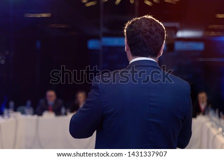 Young businessman at business conference room with public giving presentations. Audience at the conference hall. Entrepreneurship club. #1431337907