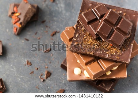 Handmade chocolate bars with nuts and goji berry on a grey background, tp view #1431410132