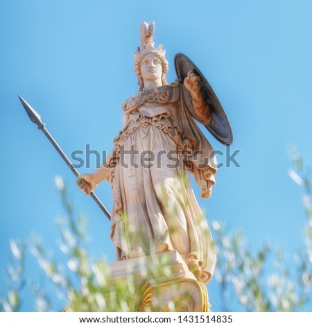 Athena marble statue with helmet, spear and shield, over some olive tree leaves, Athens Greece #1431514835