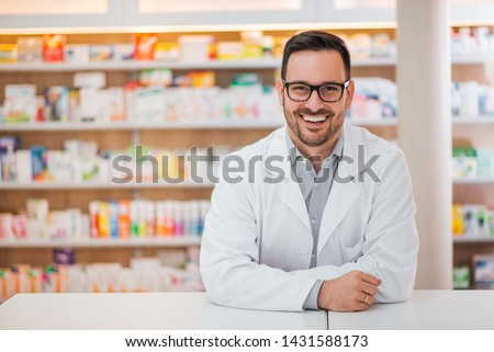 Smiling portrait of a handsome pharmacist. #1431588173
