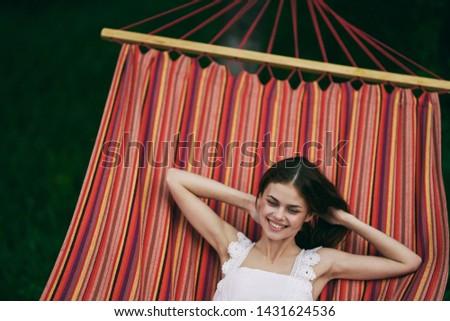 Pretty woman lying in a hammock leisure landscape leisure nature resort relax #1431624536