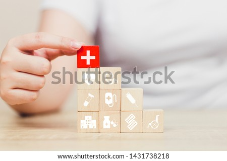 Health Insurance Concept,hand arranging wood block stacking with icon healthcare medical. #1431738218