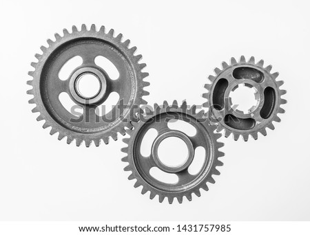 Teamwork business concept - top view of 3 metal gear isolated on white background for mockup. real photo, not 3D render #1431757985