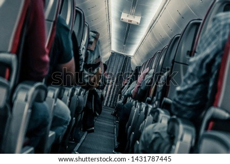 Plane danger. Passengers in shock in a turbulence area Royalty-Free Stock Photo #1431787445