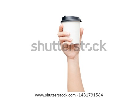 Take away coffee cup background. Female hand holding a coffee paper cup isolated on white background with clipping path. Close-up image. #1431791564