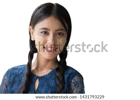 A beautiful  Myanmar woman, Yangon Myanmar,vintage style. Young Myanmar girls with Thanaka, a yellowish-white paste made from ground bark and used as a cosmetic and for sunburn protection. #1431793229