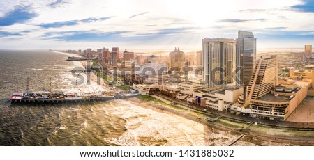 Late afternoon aerial panorama of Atlantic city along the boardwalk. Atlantic City achieved nationwide attention as a gambling resort and currently has nine large casinos. Royalty-Free Stock Photo #1431885032