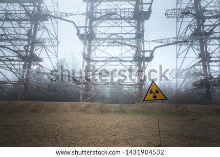 Large radar antenna in the fog with radiation warning sign #1431904532