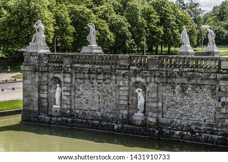 Sculptures by Basin of waterfalls (Bassin des cascades, 1866) in beautiful Public Park near Palace of Fontainebleau (Chateau de Fontainebleau, 1137). Fontainebleau, suburban of Paris (55 km), France. #1431910733