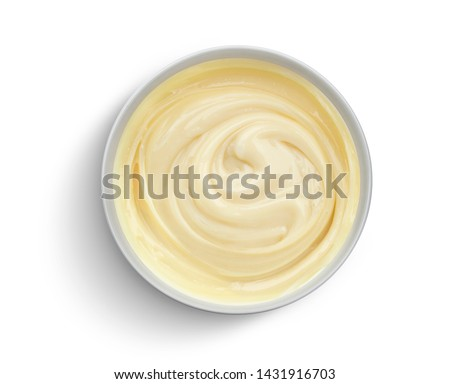 Bowl of condensed milk cream isolated on white background with clipping path, top view Royalty-Free Stock Photo #1431916703
