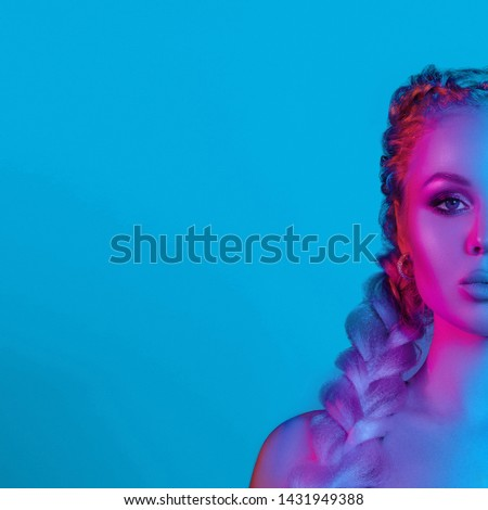 Gorgeous fashionable woman in the lights.blue and red light #1431949388