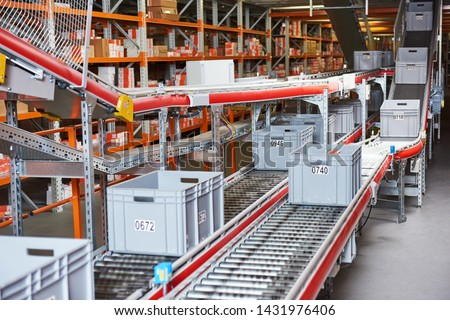 Automated warehouse. Boxes with spare parts moving on conveyer #1431976406
