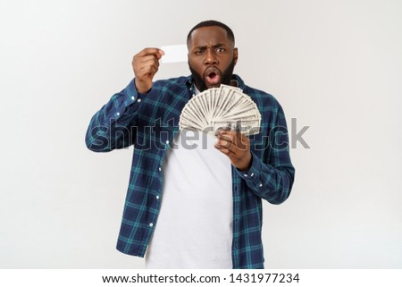 stylish african american in costume holding white credit card and money in studio on white background. #1431977234