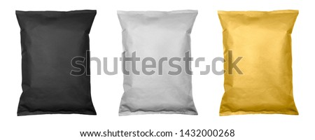 White, black and gold pillow bag of chips , snacks or candys top view. Isolated on a white background. Royalty-Free Stock Photo #1432000268