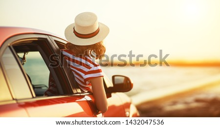 happy woman girl goes to summer travel trip in the  car #1432047536