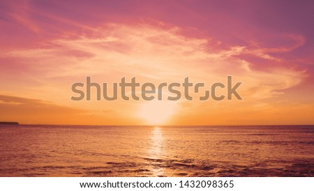 Red sundown sea. The coast of the Caribbean Sea, the yellow sun touches the horizon, beautiful orange clouds around the sun. Amazing view from the beach to the red sundown sea. Beautiful sea landscape #1432098365